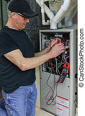 Furnace Repairman Servicing High Efficiency System