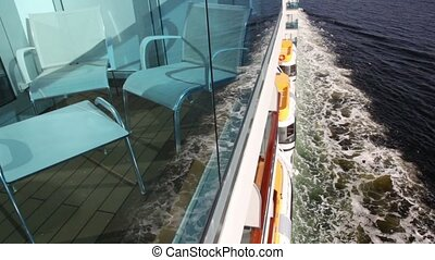 Furniture at balcony and rescue boats on board of vessel