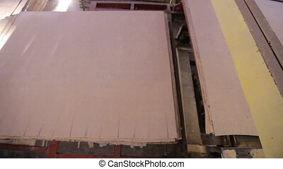 Manufacturing of plywood in a furniture factory. Natural environmentally friendly materials