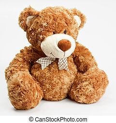 Furry teddy bear - A stuffed sitting toy bear with fluffy...