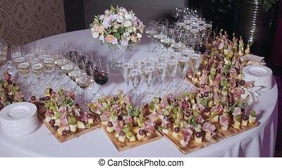 Furshet. Table top full of glasses of sparkling white wine...