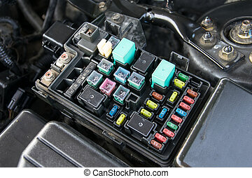 fuse box detail of a car engine bay with fuses Engine Timing Cover fuse box detail of a car engine bay with fuses