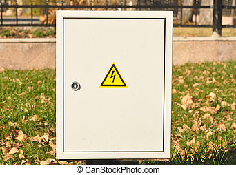 Fuse box with black/yellow sign warning for risk of ...