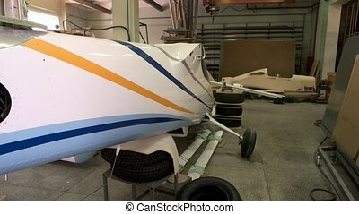 Fuselage in a workshop. Part of an aircraft. Helicopter manufacturing company.