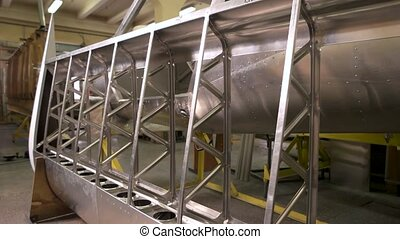 Fuselage part in aircraft workshop.