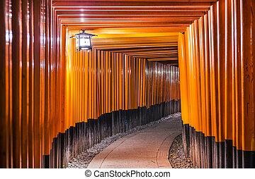Fushimi Inari Taisha Shrine torii gates in Kyoto, Japan at...