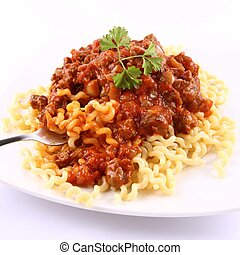 Fusilli bucati lunghi with bolognese sauce being eaten with a fork