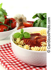 cooked pasta with tomato sauce and basil
