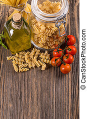 Fusilli in a jar with olive oil and tomatoes