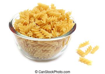 Fusilli pasta in a glass bowl on white background