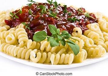 Fusilli pasta with tomato and vegetable sauce over white...