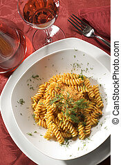 fusilli pasta with tomato sauce and herb