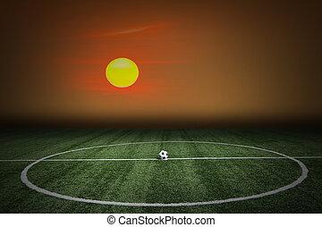 futebol, grama verde, campo, em, pôr do sol