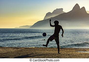futebol praia, pôr do sol