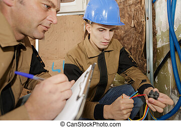 future electrician holding the cable wires