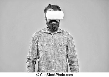 Future is closer than you think. Bearded man explore VR yellow background. VR technology and future. VR communication. Exciting impressions. Hipster wear VR glasses. Gaming and entertainment