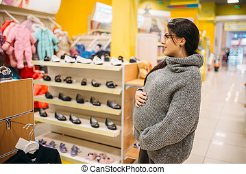 Future mother in the store, shoe department