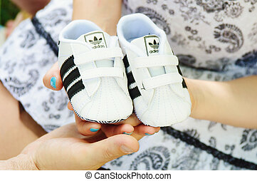 future parents hold bootees of the kid