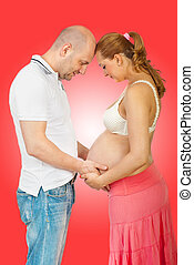 Future parents in touch with their unborn baby