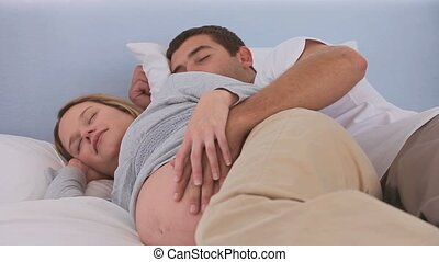 Future parents sleeping together