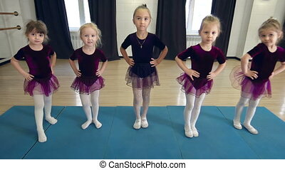 Future Primas - Close up of five girls extending their feet...