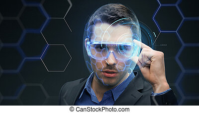 businessman in 3d glasses with virtual hologram