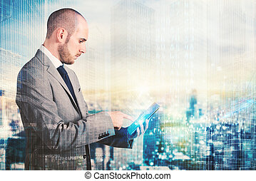 Future technology - Businessman using a tablet with...