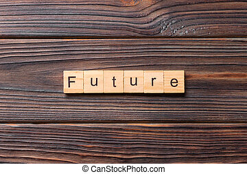 Future word written on wood block. Future text on wooden table for your desing, concept
