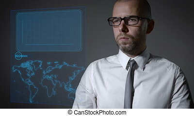 Future work with finance and macro economy. Businessman working with an interactive holographic screen.