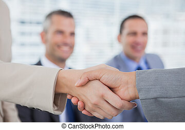 Future workmates shaking hands