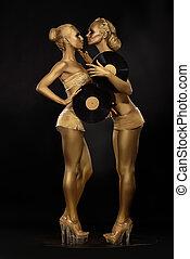 Futurism. Creativity. Glossy Golden Women with Vinyl Record...