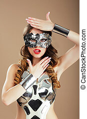 Futurism. Robotic Woman in Cosmic Mask and Metallic Stagy Costume Gesturing