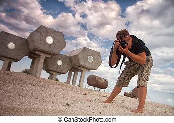 futurist photographer - male photographer in the desert near...