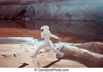 futuristic astronaut on another planet, image with the effect of toning
