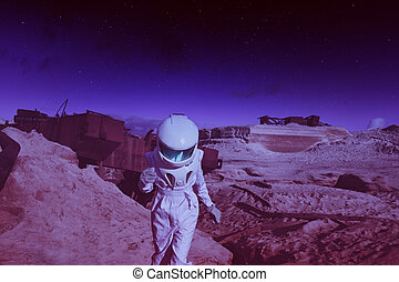 futuristic astronaut on another planet, Mars. image with the effect of toning