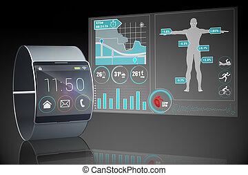 Futuristic black wristwatch with interface on black...