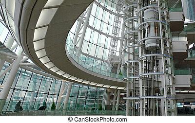 interior of modern futuristic building - public hall of japanese airport