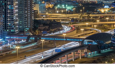 Futuristic building of Dubai metro and tram station and...