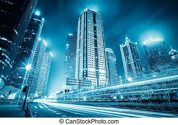 futuristic city with light trails - modern building at night...