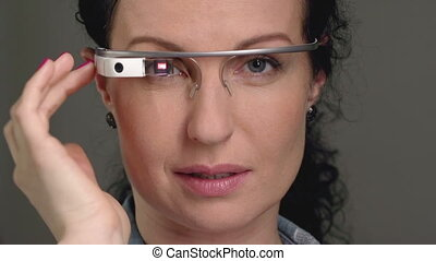 Futuristic Eyewear - Close up of lady%u2019s face wearing...
