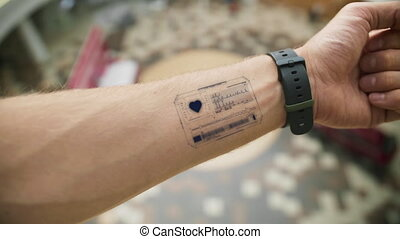 Futuristic heartbeat screen on the hand of the man