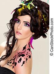 Futuristic luxury hairdo. Bright makeup and tattoo. Beauty