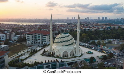 Futuristic Marmara Mosque in Istanbul, Modern looking Mosque at Sunset with Cityscape, Aerial Hyperlapse Drone Time Lapse forward 4K