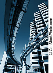 Futuristic monorail going around skyscrapers. Wide angle...