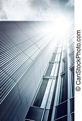 futuristic glass and steel skyscraper seen from below, Frankfurt am Main, Germany
