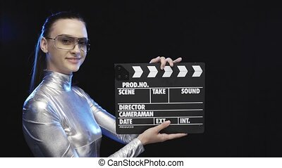 Futuristic woman in silver suit smiling at camera -...