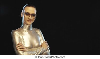Futuristic woman in silver suit smiling at camera