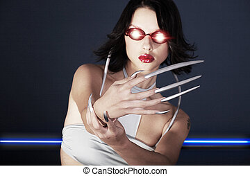 Futuristic woman with long nails