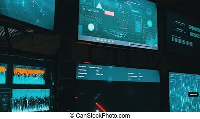 Futuristic workplace - several keyboards and monitors. Mid ...