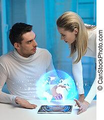 futuristico, uomo donna, con, globo, ologramma